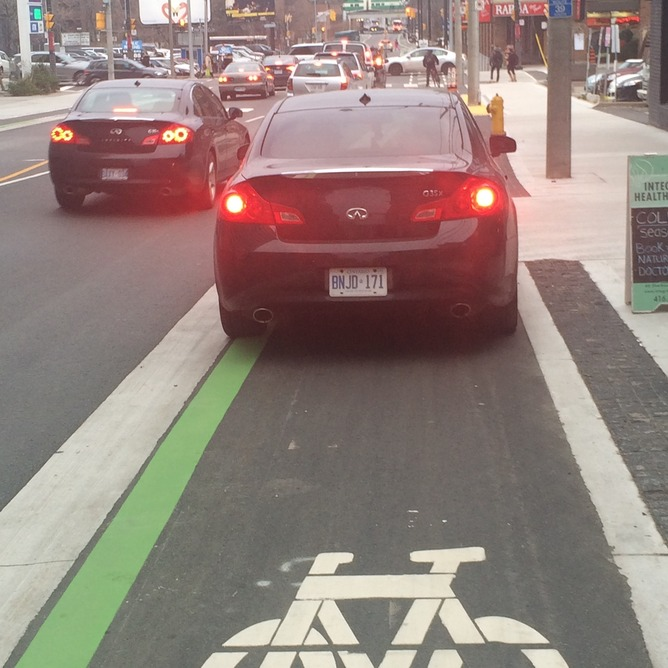Car parked in protected bike lane