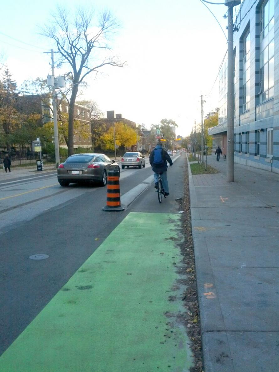 Sherbourne separated bike lane and cyclist